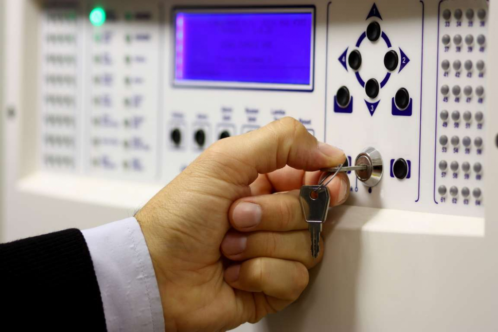 Activating an alarm system at the end of the day to ensure there is no employee theft