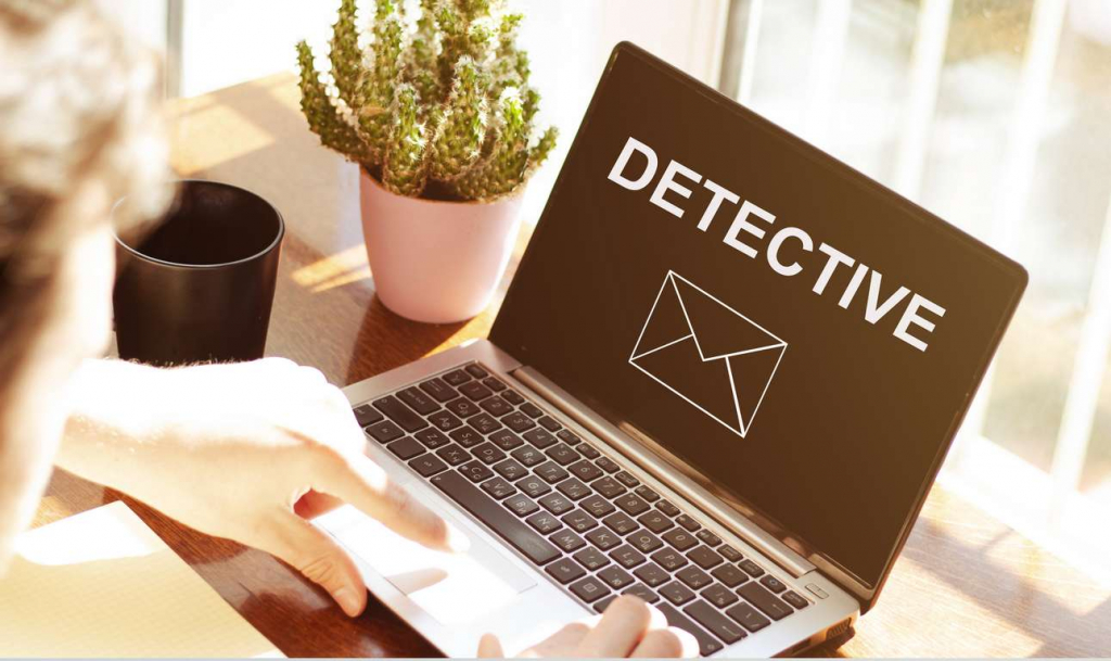 Online Private Investigator checking their detective email on a laptop