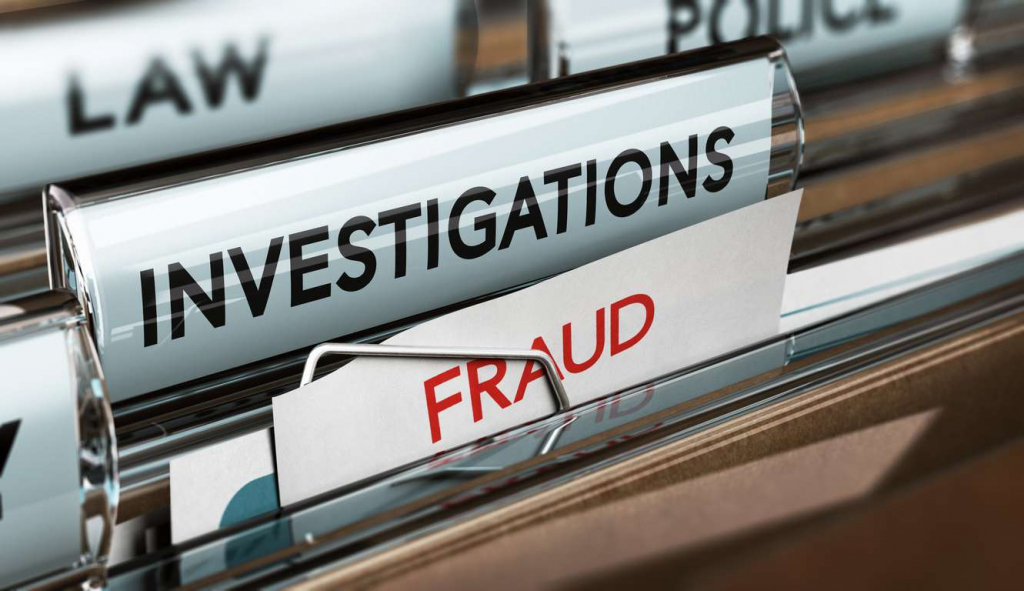 Filing cabinet with fraud investigation files and evidence